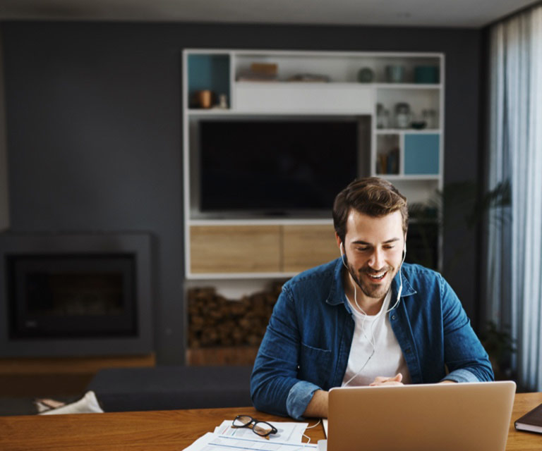 Man sitting in front of the laptop smiling