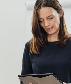 Woman looking at tablet