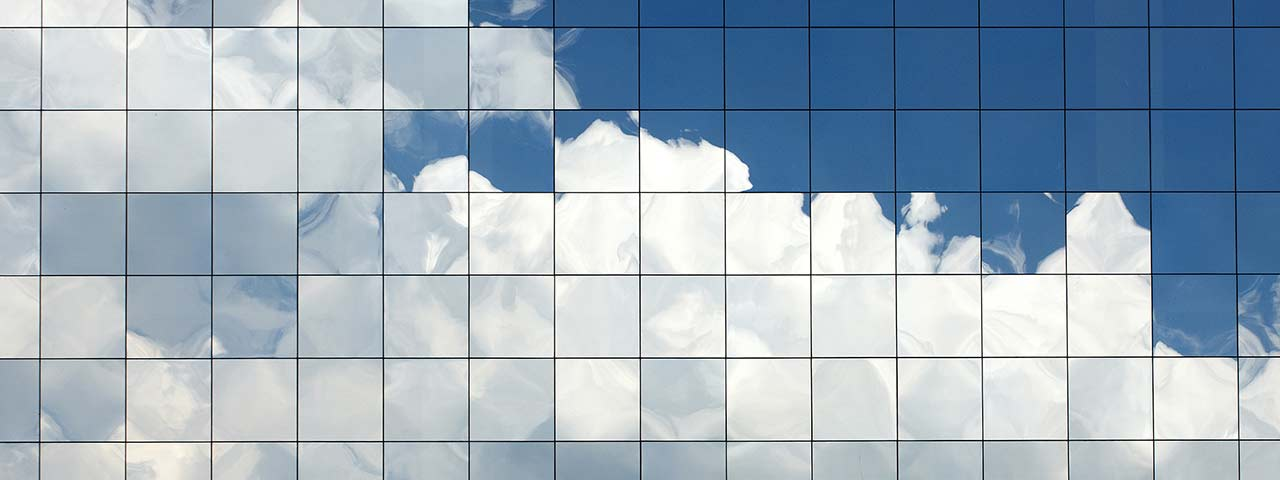 Clouds reflecting from glass windows