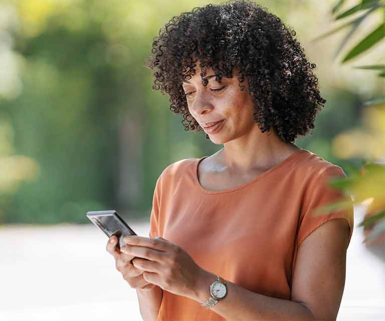 Woman looking down at smartphone