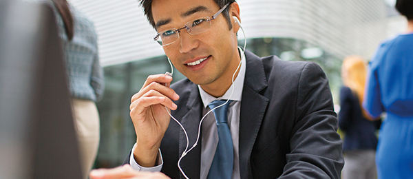Man touching the volume on his headphones