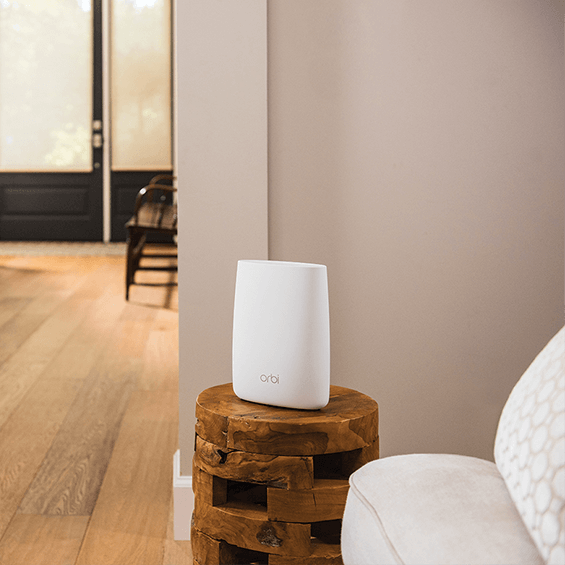 Lifestyle view of the Netgear Orbi  Add-on Satellite in the foyer