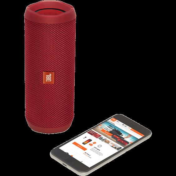 Altavoz JBL Flip 4 rojo con teléfono móvil - Vista frontal