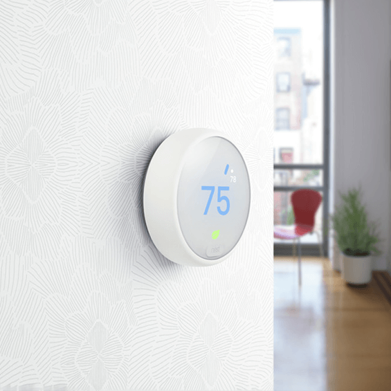 Nest Thermostat E mounted on a wall in living space