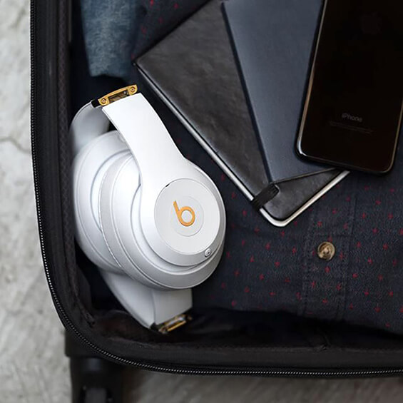 View of Beats Studio 3 Headphones folded and stowed in a suitcase