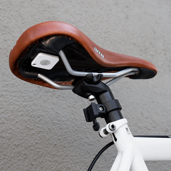 Tile Mate Bluetooth Tracker attached under a bicycle seat